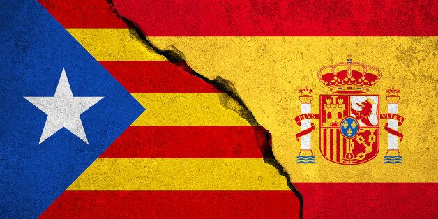 spain flag on broken brick wall and half catalan flag, vote referendum for catalonia independence exit...