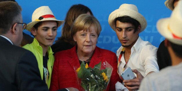 SCHWERIN, GERMANY - SEPTEMBER 19: German Chancellor and Christian Democrat (CDU) Angela Merkel poses...