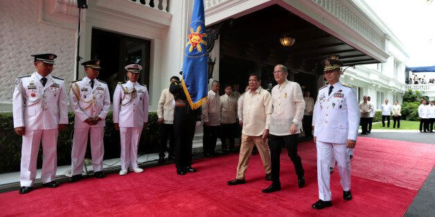 MANILA, PHILIPPINES - JUNE 30: In this handout image provided by Malacanang Photo Bureau, Outgoing President...