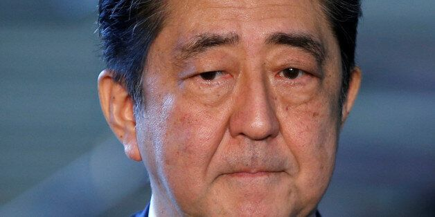 Japan's Prime Minister Shinzo Abe speaks to media after North Korea's missile launch, at his official...