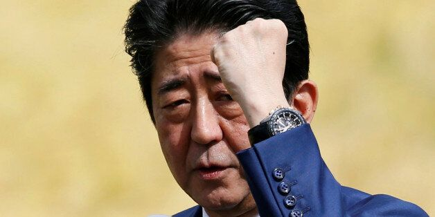 Japan's Prime Minister Shinzo Abe, who is also ruling Liberal Democratic Party leader, attends an election...