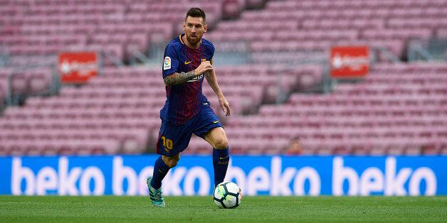 BARCELONA, SPAIN - OCTOBER 01: Lionel Messi of Barcelona runs with the ball during the La Liga match...