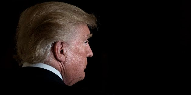 TOPSHOT - US President Donald Trump leaves after a Hispanic Heritage Month event in the East Room of...