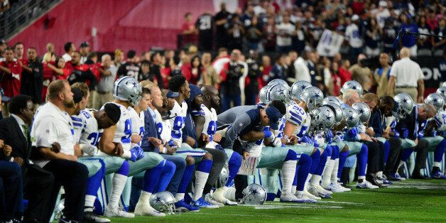 Sep 25, 2017; Glendale, AZ, USA; The Dallas Cowboys players, coaches and staff take a knee prior to the...