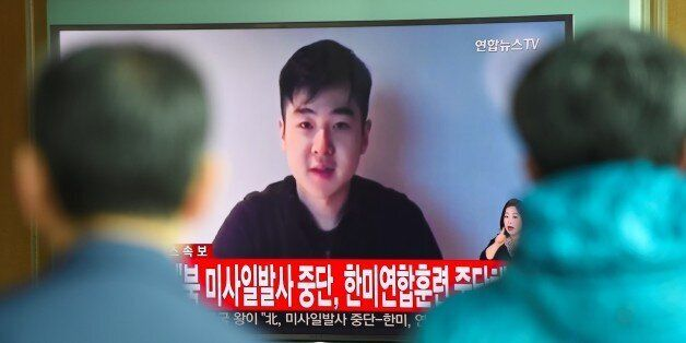 South Koreans watch a television news showing a video footage of a man who claims he is Kim Han-Sol,...