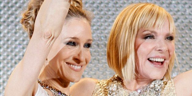Cast members Sarah Jessica Parker (L) and Kim Cattrall attend the Japan premiere