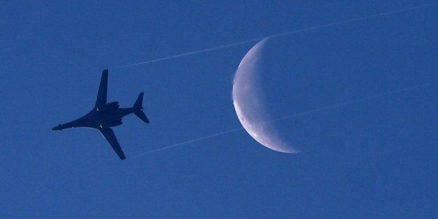A US Air Force B-1 Lancer bomber flies above the Syrian town of Kobane, also known as Ain al-Arab, on...
