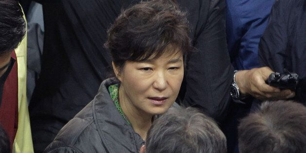 JINDO-GUN, SOUTH KOREA - APRIL 17: South Korean President Park Geun-Hye talks with relatives of missing...