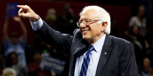 U.S. Democratic presidential candidate Bernie Sanders points and smiles at a campaign rally in New Brunswick,...