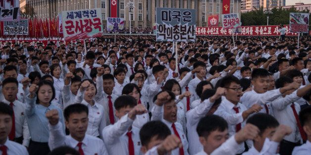 Students march during a mass rally on Kim Il-Sung sqaure in Pyongyang on September 23, 2017.Tens of thousands...