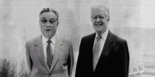Former President Jimmy Carter (R) poses with North Korean President KimIl-sung in Pyongyang June 17....