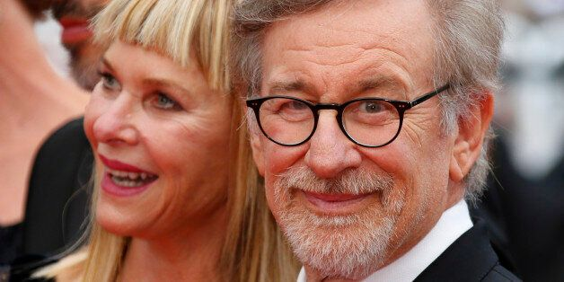 Director Steven Spielberg and his wife Kate Capshaw pose on the red carpet as they arrive for the screening...