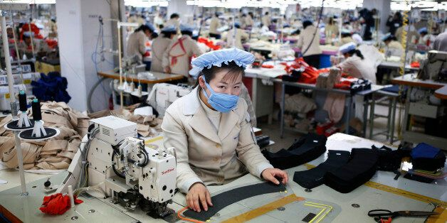 A North Korean employee works in a factory of a South Korean company at the Joint Industrial Park in...