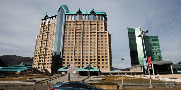A vehicle drives past Kangwon Land Corp. hotel and casino building in Sabuk, Jeongseon, South Korea,...