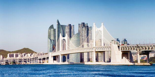 Panoramic view of the Gwangandaegyo Bridge in Busan, South Korea, with the ultra modern buildings of...