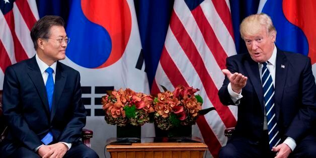 South Korea's President Moon Jae-in and US President Donald Trump wait for a meeting at the Palace Hotel...