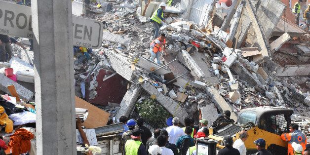 Rescuers are seen during the helping people after 7.1 earthquake ocurred in Mexico City on September...