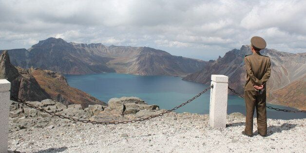 [UNVERIFIED CONTENT] Soldier on Mount Paektu North Korea overlooking Lake