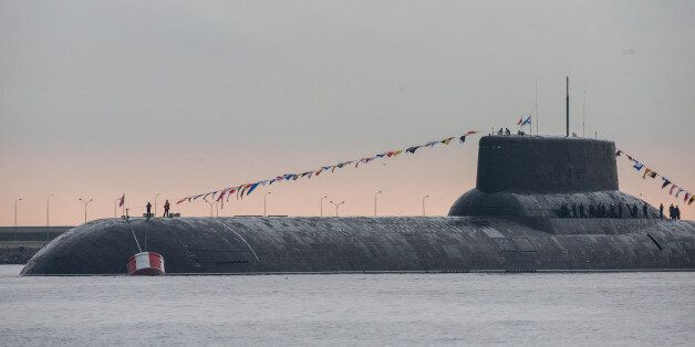 Russian Navy's TK-208 Dmitry Donskoy nuclear submarine is prepared for the Navy Day parade in Kronshtadt...