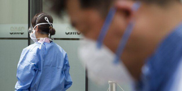 SEOUL, SOUTH KOREA - JUNE 15: A hospital worker wearing protective gear preparing medical on quarantine...