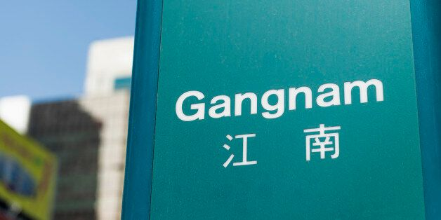 A sign for Gangnam subway station. Gangnam is a district located south of the Han River in South Korea's...