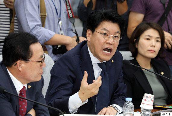 김명수 대법원장 후보자가 장제원 질의에 웃었다 사과한