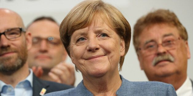 BERLIN, GERMANY - SEPTEMBER 24: German Chancellor and Christian Democrat (CDU) Angela Merkel smiles while...