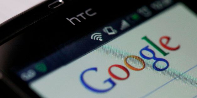 The Google Inc. company logo is seen on an HTC Touch HD smartphone in this arranged photograph in London,...