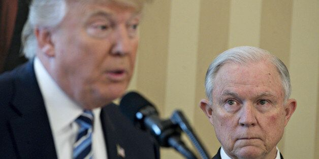 Jeff Sessions, U.S. attorney general, right, listens as U.S. President Donald Trump speaks before Sessions...