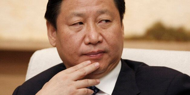 Shanghai Communist Party boss Xi Jinping attends Shanghai delegation discussion sessions of the 17th...