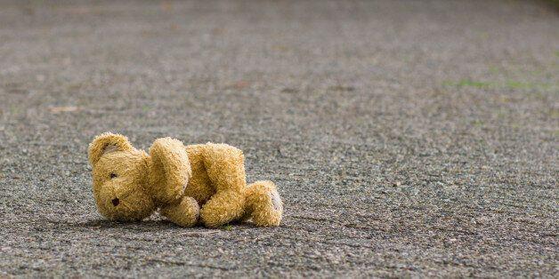 Teddy bear lies on the