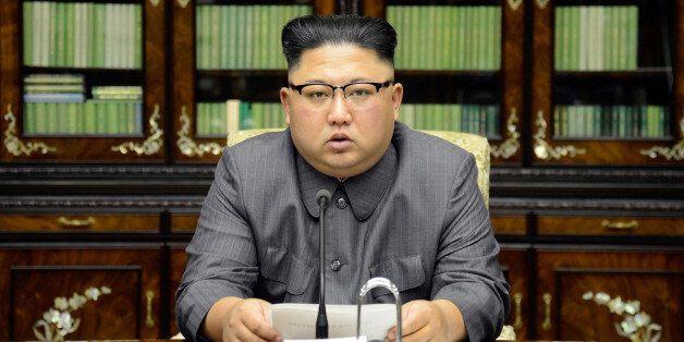 North Korea's leader Kim Jong Un makes a statement regarding U.S. President Donald Trump's speech at...