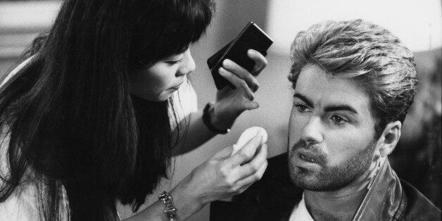 English singer and songwriter George Michael (1963-2016) pictured receiving attention from a make up...