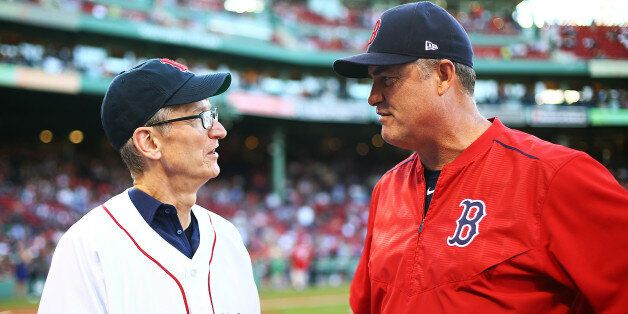 BOSTON, MA - JUNE 09: CEO of Apple Tim Cook talks to Boston Red Sox Manager John Farrell before a game...
