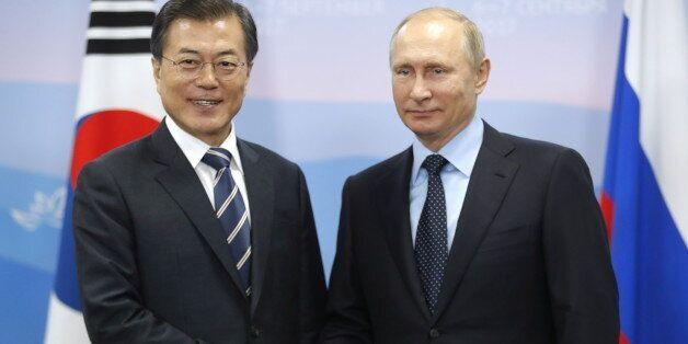 VLADIVOSTOK, RUSSIA - SEPTEMBER 6, 2017: South Korea's President Moon Jae-in (L) and Russia's President...