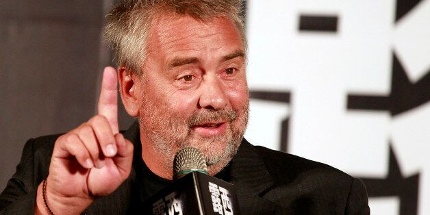 French film director Luc Besson gestures while answering a question during a news conference to promote...