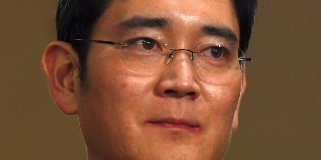 Lee Jae-Yong, vice chairman of Samsung Electronics, arrives for questioning at the office of a special...