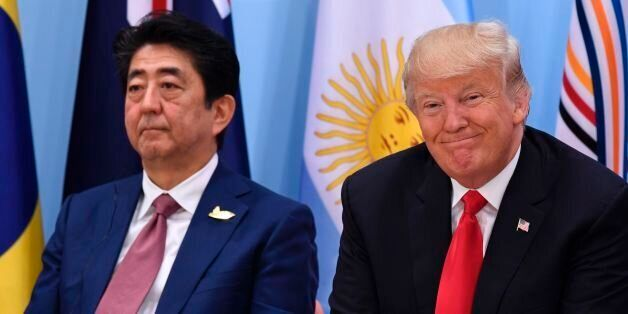 US President Donald Trump (R) and Japan's Prime Minister Shinzo Abe attend the panel discussion 'Launch...