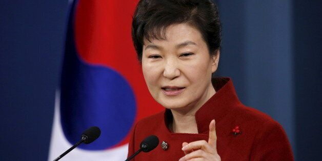 South Korean President Park Geun-hye answers questions from reporters during her New Year news conference...