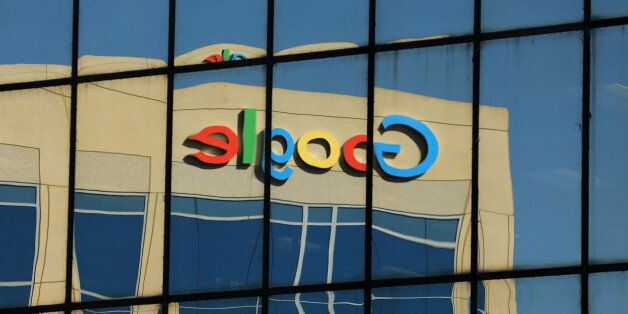 The Google logo is shown reflected on an adjacent office building in Irvine, California, U.S. August...