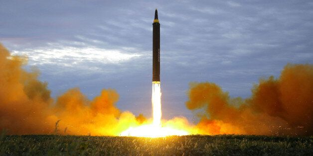 A missile is launched during a long and medium-range ballistic rocket launch drill in this undated photo...