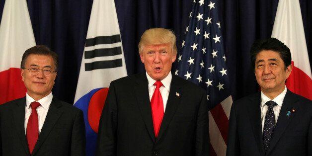 U.S. President Donald Trump meets South Korea's President Moon Jae-In and Japanese Prime Minister Shinzo...