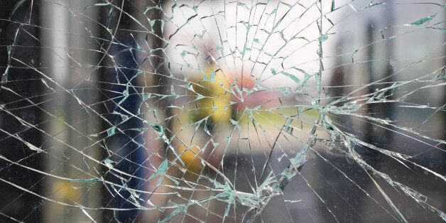 Glass broken cracks splinters in front of the bus