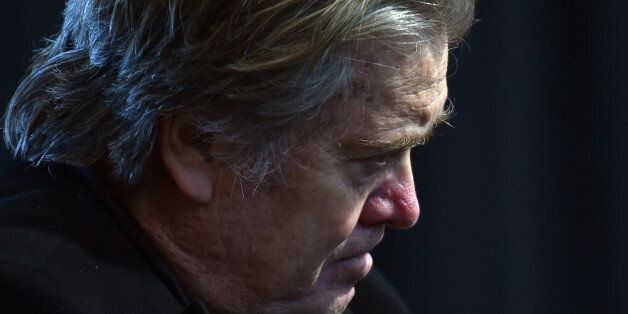 Assistant and White House chief strategist to US President Donald Trump, Steve Bannon listens as Trump...