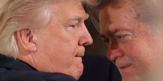 FILE PHOTO: U.S. President Donald Trump talks to chief strategist Steve Bannon during a swearing in ceremony...