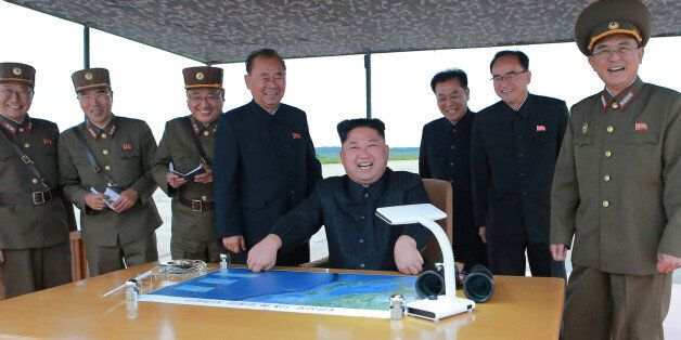 North Korean leader Kim Jong Un inspects a long and medium-range ballistic rocket launch drill in this...
