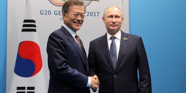 HAMBURG, GERMANY - JULY 7, 2017: South Korea's President Moon Jae-in (L) and Russia's President Vladimir...