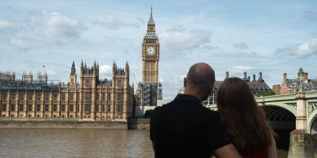 A couple hug agains the backdrop of the Elizabeth Tower, known as 'Big Ben' and the Houses of Parliament,...