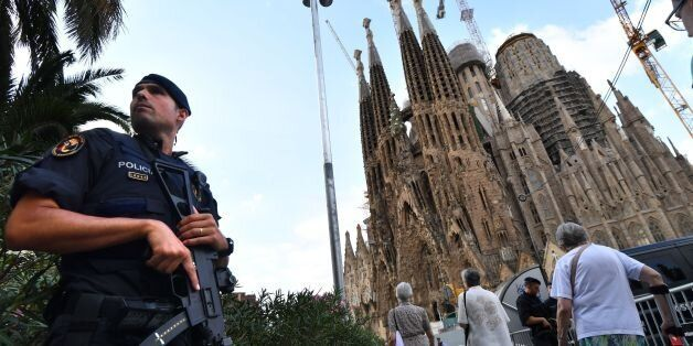 TOPSHOT - A police officer stands by the Sagrada Familia basilica in Barcelona on August 20, 2017, before...
