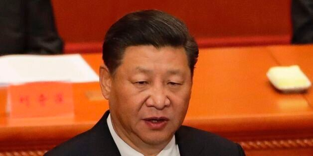 China's President Xi Jinping speaks during a ceremony to commemorate the 90th anniversary of the founding...